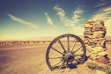 Retro style old cartwheel, wild west concept, Death Valley, USA.