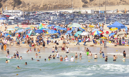 santa monica: Santa Monica, USA - August 22, 2015: Beach full of people during peak season. Santa Monica had become famous resort town by the early 20th century.