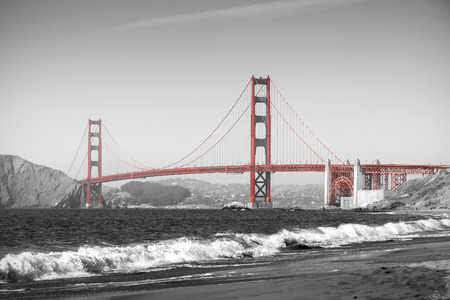 Red Golden Gate Bridge in San Francisco, black and white filter. Stock Photo