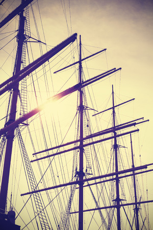 wooden boat: Retro vintage toned sailing masts at sunset, travel concept.