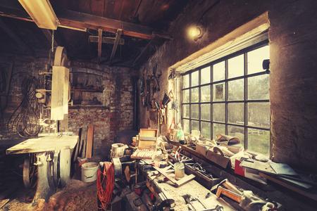 Vintage stylized old carpenter workshop interior.