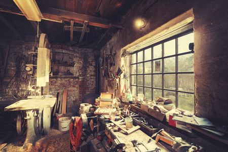 Vintage stylized old carpenter workshop interior.