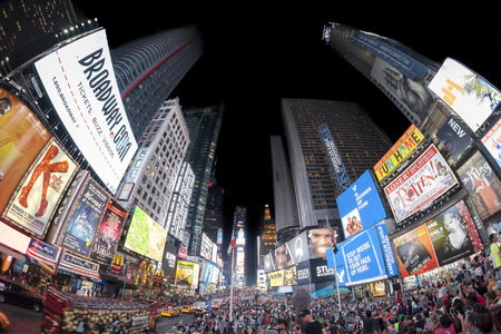 city trip: New York, USA - August 18, 2015: Fisheye lens photo of Times Squares crowded with tourists at night with Broadway Theaters and animated LED signs.