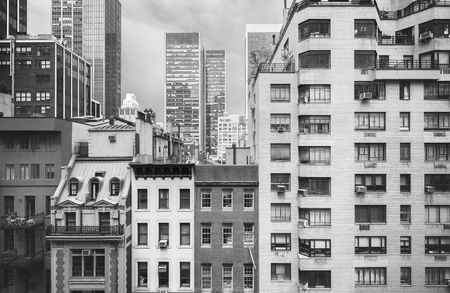 old buildings: Black and white photo of New York buildings, USA.