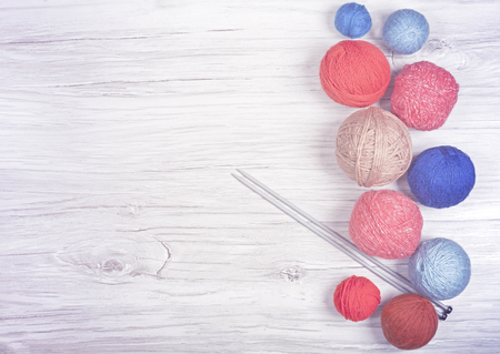 kink: Vintage toned yarn balls on wooden boards, hobby concept background, space for text.