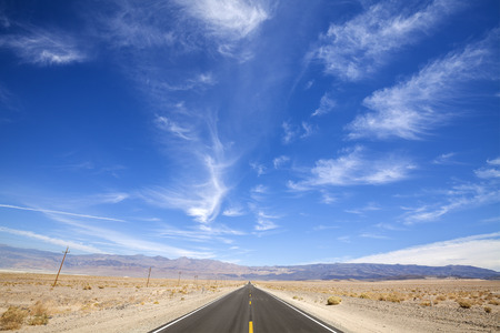 outsider: Endless country highway, Death Valley, USA, space for text. Stock Photo