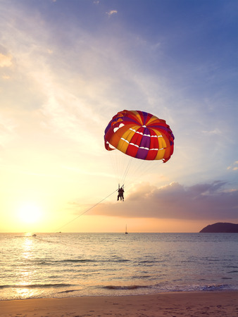 langkawi island: Paragliders at sunset, summer adventure concept, Langkawi Island in Malaysia.