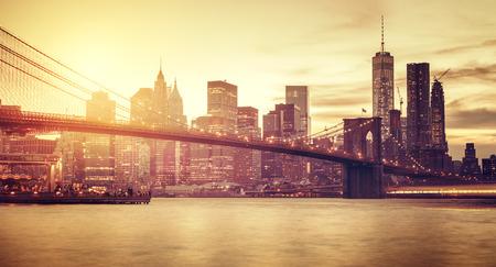 broadway tower: Retro stylized Manhattan at sunset, New York, USA. Stock Photo
