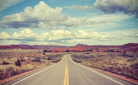 road: Vintage stylized desert road, travel concept.