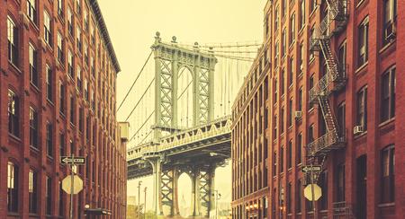 Retro stylized Manhattan Bridge seen from Dumbo, New York.