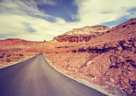lanes: Vintage toned scenic road without lanes, USA. Stock Photo