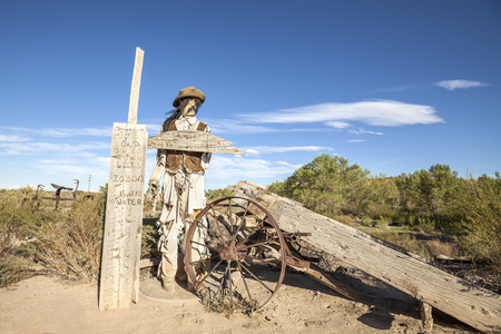 inhabited: Giles, Utah, USA - September 4, 2015: Cowboy figure in Giles ghost town. The town was inhabited about 1883 - 1919.