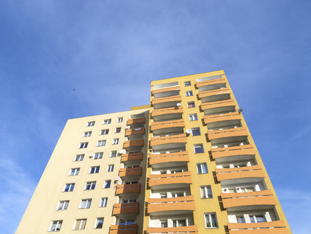 residential: Residential apartment against blue sky.