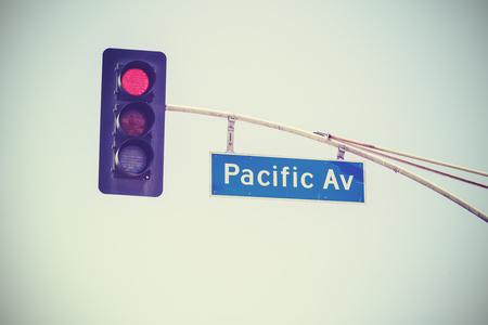 av: Retro stylized traffic lights and Pacific Av street sign, USA.