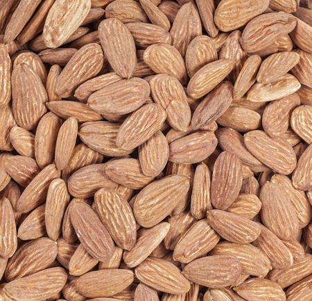 close up food: Close up picture of almonds, food background. Stock Photo