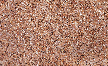 close up food: Close up of flax seeds, food background.