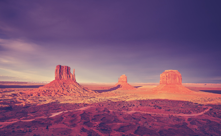 arizona scenery: Vintage toned picture of sunset over Monument Valley, USA.