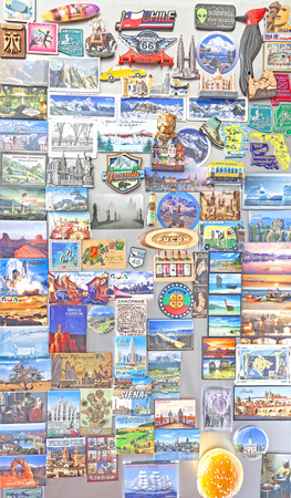 popular: Szczecin, Poland - March 08, 2016: Souvenir magnets from all over the world on refrigerator. Magnets became popular travel gifts and collectible objects. Editorial