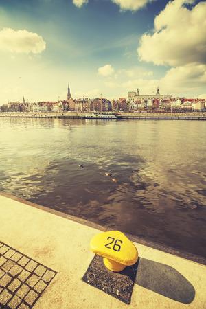 bollard: Retro stylized bollard by Szczecin waterfront, Poland. Stock Photo