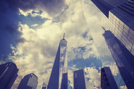 freedom tower: Vintage toned Manhattan skyline with Freedom Tower in a cloudy day, wide angle lens, NYC, USA.