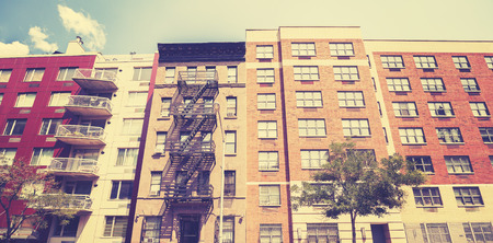 fire escape: Vintage toned photo of New York building with fire escape ladder, USA. Stock Photo
