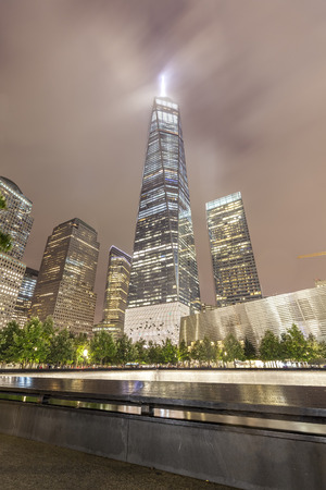 september 11: New York, USA - September 13, 2015: Night picture of The National September 11 Memorial pool and Freedom Tower.