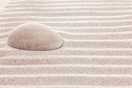 spiritual background: Stone in sand, spa or spiritual background.