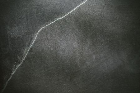 schist: Dark grunge stone background, close up of a slate.