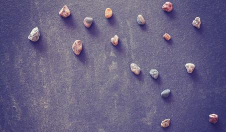 schist: Vintage filtered stones on dark grunge slate background.