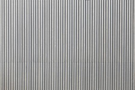 Gegolfd metalen dak, bovenstaande foto, industriële achtergrond of textuur. Stockfoto