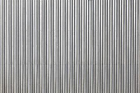 Corrugated metal roof, picture taken from above, industrial background or texture. Standard-Bild