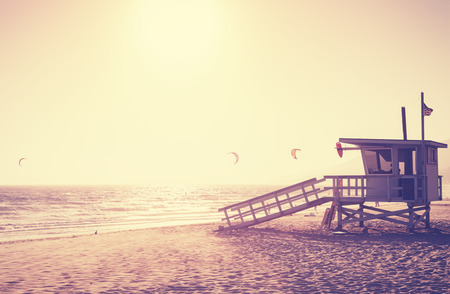 lifeguard tower: Vintage toned picture of lifeguard tower at sunset, Malibu, USA. Stock Photo