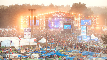 Kostrzyn nad Odra, Poland - August 1, 2015: Evening concert on main stage and tents at the 21th Woodstock Festival Poland (Przystanek Woodstock).
