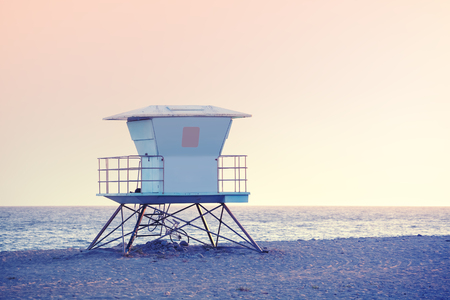 lifeguard tower: Rose quartz and serenity color toned picture of a lifeguard tower at sunset in Santa Barbara, USA. Stock Photo