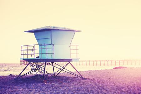 Vintage toned picture of a lifeguard tower at sunset, Santa Barbara, USA.