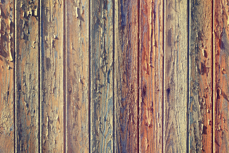 peeling paint: Vintage toned old wooden boards with peeling paint.