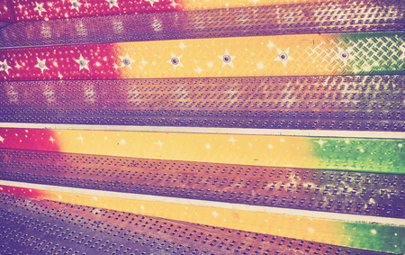 to scrape: Vintage toned abstract grungy background made of metal stairs.