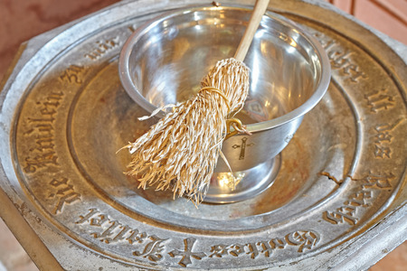baptismal: Baptismal font with sprinkler, shallow depth of field.