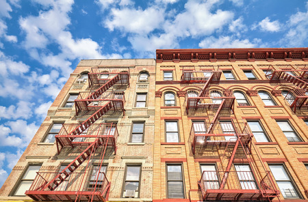 fire escape: Residential building with fire escape ladders in New York City, USA.