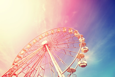 Vintage toned picture of a Ferris wheel at sunset. Reklamní fotografie - 59385193