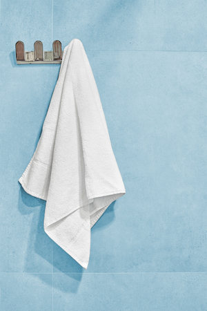 white towels: White towel hanging on a wall in bathroom.