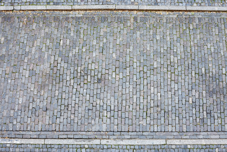 Cobblestone street and pavement from above. Imagens