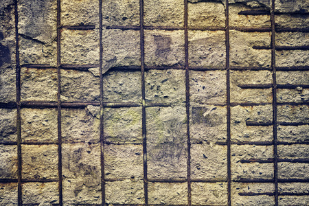 gritty: Vintage toned background made of reinforced concrete wall. Stock Photo