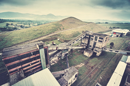 cloudy day: Retro toned old abandoned coal mine in cloudy day.