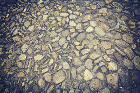cobblestones: Vintage toned old street cobblestones background.