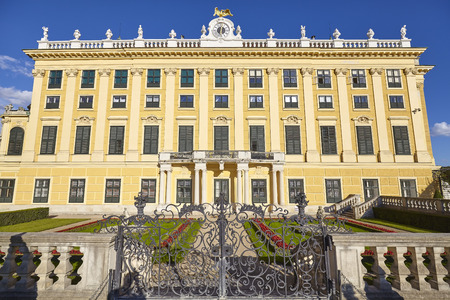 schoenbrunn: Vienna, Austria - August 14, 2016: Side view of the Schonbrunn Palace, former imperial summer residence and a major tourist attraction in the city. Editorial