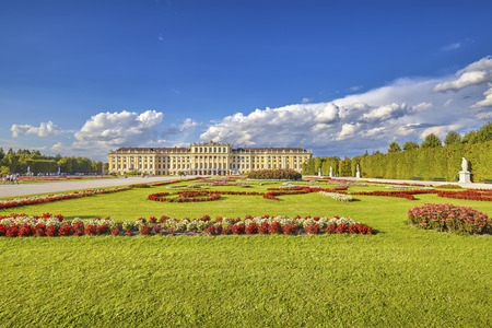 schoenbrunn: Vienna, Austria - August 14, 2016: Garden in the Schonbrunn Palace complex, former imperial summer residence and a major tourist attraction in the city.