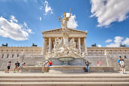 Vienna, Austria - August 14, 2016: The Austrian Parliament Building and Pallas Athena fountain.