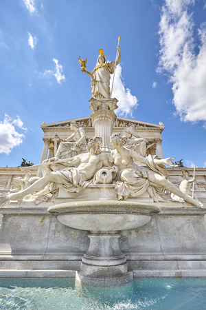 Vienna, Austria - August 14, 2016:  Pallas Athena fountain in front of the main entrance to the Austrian Parliament Building.
