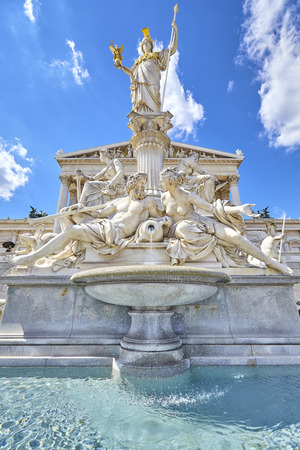 pallas: Vienna, Austria - August 14, 2016:  Pallas Athena fountain in front of the main entrance to the Austrian Parliament Building.